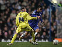 Photo: Lee Earle.<br /> Chelsea v Colchester United. The FA Cup. 19/02/2006. Chelsea's Paulo Ferreira (R) battles with Mark Yates.