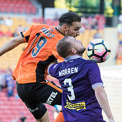 BRISBANE, AUSTRALIA - OCTOBER 30:  Jack Hingert of the roar and Marc Warren of the Glory compete for the ball during the round 4 Hyundai A-League match between the Brisbane Roar and Perth Glory at Suncorp Stadium on October 30, 2016 in Brisbane, Australia. (Photo by Patrick Kearney/Brisbane Roar)