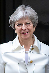 © Licensed to London News Pictures. 16/04/2018. London, UK. Prime Minister Theresa May leaves 10 Downing Street to greet Nigerian President Muhammadu Buhari. Photo credit: Rob Pinney/LNP