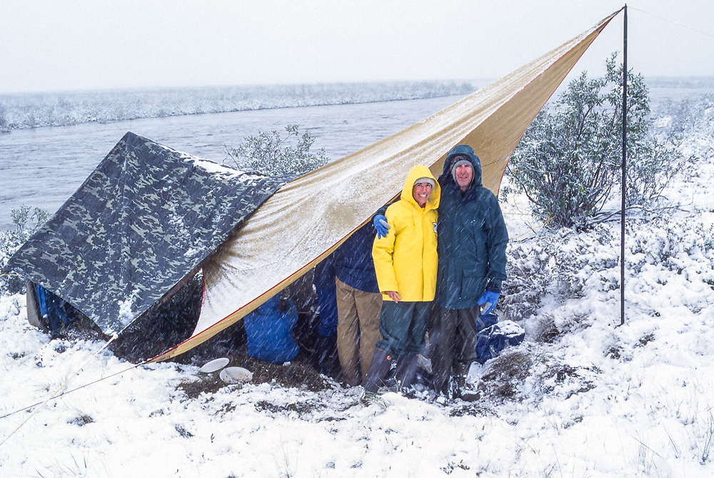 Pat and John Willits, Noatak River campsite during a snowstrom, Gates of the Arctic National Park, Alaska, USA, August 1994