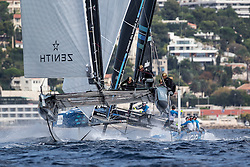 Spindrift racing was the top performing boat of day 2 at Marseille One Design, the finale of the Bullitt GC32 Racing Tour 2015. Yann Guichard got the best of the starts and won two of today's five races, slightly closing the points gap to the regatta leader Alinghi. Here you see them foiling at around 30 knots coming in to the bottom mark with another GC32 in the background.<br /> <br /> Marseille One Design event for the Bullitt GC32 Racing Tour.