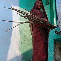 Asia, India, Khajuraho. Woman in red sari in Khajuraho, India.