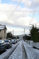 Burdette Avenue Dun Laoghaire with a view to the sea, snow covered road