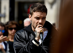 One Direction star Liam Payne performing outside Oxford Circus underground station in London.