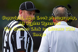 BLOOMINGTON, IL - September 28:  Brandon White and Norm Eash share a light moment during a college football game between the IWU Titans and the Augustana Vikings on September 28 2019 at Wilder Field in Tucci Stadium in Bloomington, IL. (Photo by Alan Look)