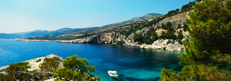panoramic view of small boat anchored off the Adriatic coast of Hvar island in Croatia, Europe