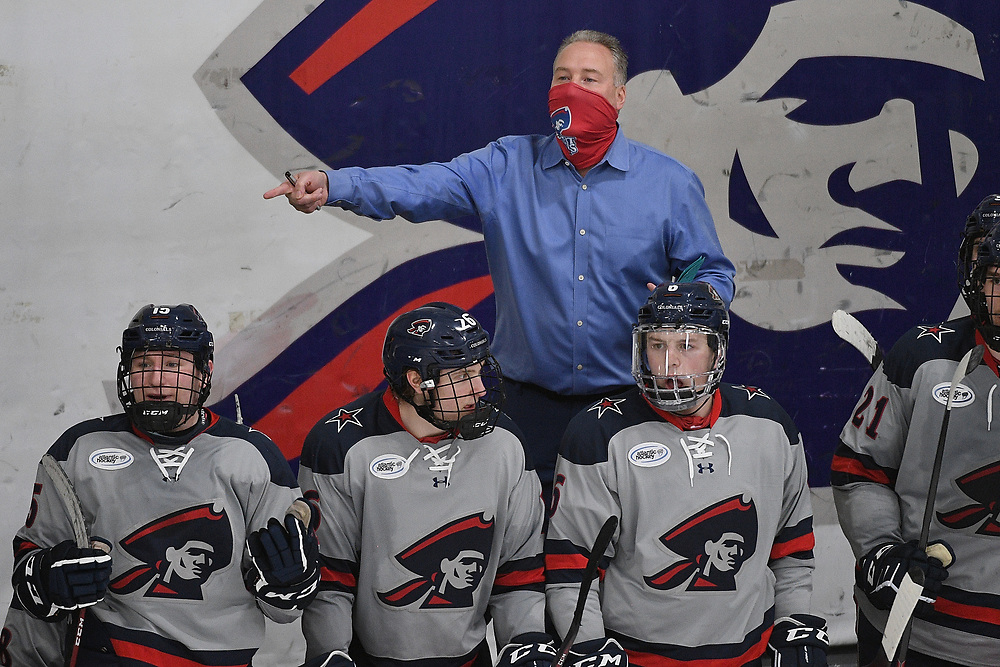 PITTSBURGH, PA - MARCH 14: Head Coach Derek Schooley of the Robert Morris Colonials yells after a call in the third period during Game Three of the Atlantic Hockey Quarterfinal series against the Niagara Purple Eagles at Clearview Arena on March 14, 2021 in Pittsburgh, Pennsylvania. (Photo by Justin Berl/Robert Morris Athletics)