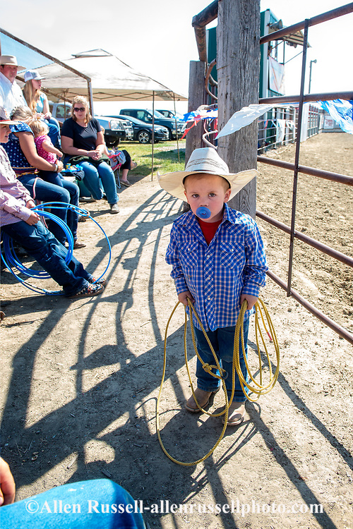Young cowboy, pacifier, lasso, Ranch Rodeo, Ingomar, Montana