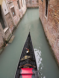 Gondola on a small canal in Venice Italy