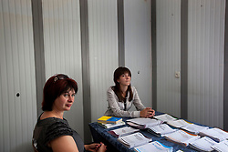 Natalia Moslovets, an attorney, meets with Natalia Padalko in a back room of the community market, Zinkiv, Ukraine, June 17, 2011. The paralegal hub is strategically located to draw people in from the community. More than half of the worldÕs population, four billion people, live outside the rule of law, with no effective title to property, access to courts or redress for official abuse. The Open Society Justice Initiative is involved in building capacity and developing pilot programs through the use of community-based advocates and paralegals in Sierra Leone, Ukraine and Indonesia. The pilot programs, which combine education with grassroots tools to provide concrete solutions to instances of injustice, help give poor people some measure of control over their lives.
