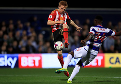 Sunderland's Ducan Watmore (left) and Queens Park Rangers' Osman Kakay (right) battle for the ball during the EFL Cup, Third Round match at Loftus Road, London.