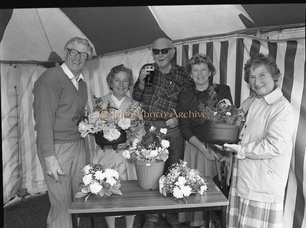 """Guinness Family Day At The Iveagh Gardens. (R83)..1988..02.07.1988..07.02.1988..2nd  July 1988..The family fun day for Guinness employees and their families took place at the Iveagh Gardens today. Top at the bill at the event were """"The Dubliners"""" who treated the crowd to a performance of all their hits. Ireland's penalty hero from Euro 88, Packie Bonner, was on hand to sign autographs for the fans...Pictured are retired Guinness staff who took part in the flower show at the Family day."""
