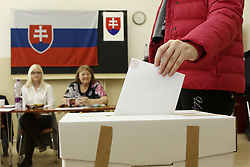 A voter casts her ballot at a polling station in Bratislava, Slovakia, March 5, 2016. The ninth general election in Slovakia's history kicked off at 7 a.m. local time (0600 GMT) Saturday, with some 4.4 million eligible voters expected to cast their vote in 5,992 polling stations nationwide for the 150-member parliament. EXPA Pictures © 2016, PhotoCredit: EXPA/ Photoshot/ Andrej Klizan<br /><br />*****ATTENTION - for AUT, SLO, CRO, SRB, BIH, MAZ, SUI only*****
