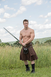 hot muscular man in a kilt