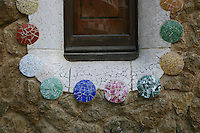 Decorative window mosaic by Antonio Gaudí in Park Güell, Barcelona, Spain<br />