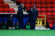 AFC Wimbledon manager Wally Downes and AFC Wimbledon first team coach Glyn Hodges stood next to dug out during the EFL Sky Bet League 1 match between Charlton Athletic and AFC Wimbledon at The Valley, London, England on 15 December 2018.