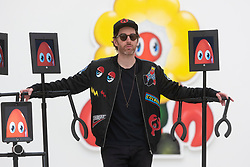"© Licensed to London News Pictures. 29/10/2020. London, UK. Artist Phillip Colbert posing with interactive robots at the press preview of his exhibition ""Lobsteropolis"" showing at the Saatchi gallery. Photo credit: Ray Tang/LNP"