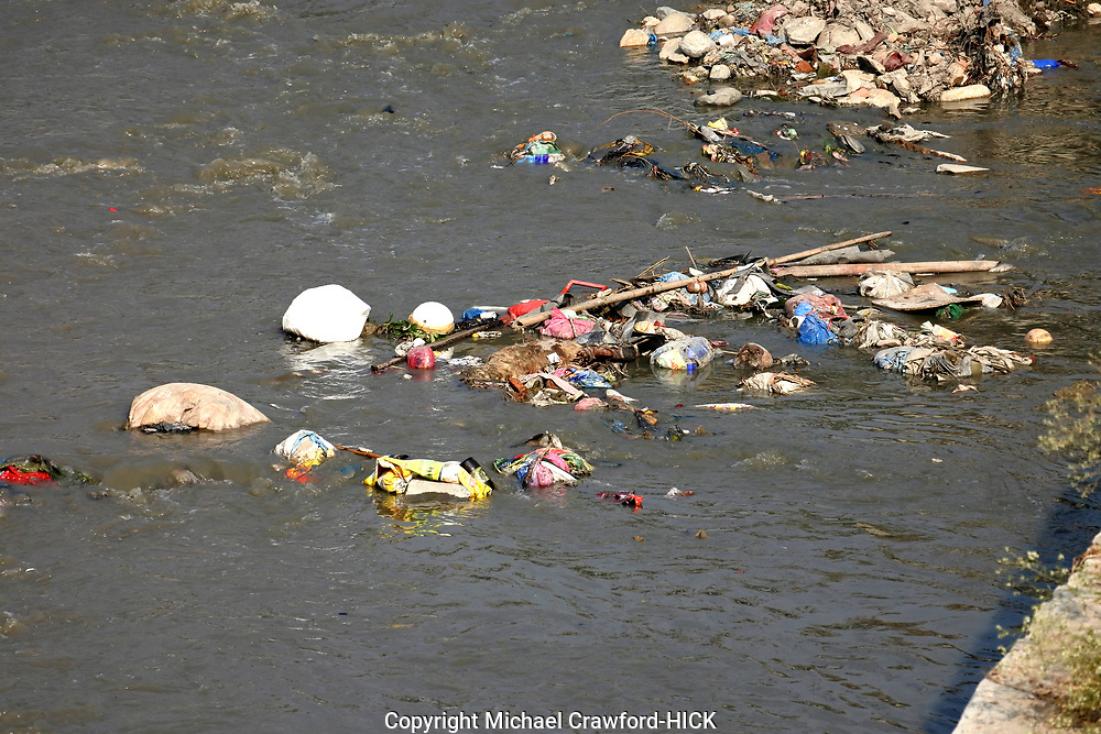 Plastic stuck in a river and accumulating