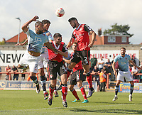 Blackpool's Kyle Vassell and Kelvin Mellor are beaten to the ball by Morecambe's Liam Wakefield and Alex Kenyon in the last minutes of the match<br /> <br /> Photographer Stephen White/CameraSport<br /> <br /> Football - The EFL Sky Bet League Two - Morecambe v Blackpool - Saturday 13th August 2016 - Globe arena - Morecambe<br /> <br /> World Copyright © 2016 CameraSport. All rights reserved. 43 Linden Ave. Countesthorpe. Leicester. England. LE8 5PG - Tel: +44 (0) 116 277 4147 - admin@camerasport.com - www.camerasport.com