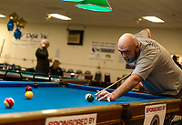Dave Smith lines up a shot during the Robbie Mills 8-Ball Tournament at the Rod and Gun on Saturday afternoon.  (Karen Bobotas/for the Laconia Daily Sun)