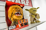 Star Wars collectables and talking soft toys (incl and animatronic Chewbacca and Yoda) on the Underground Toys Stand - The annual London Toy Fair, the trade show for the toy and games industry, takes place at Olympia.