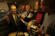 .Secretary of Defense Donald H. Rumsfeld responds to a reporter's question during an informal press briefing while en route to Washington D.C. on Nov. 18, 2003. Rumsfeld is returning from Guam, Japan and South Korea to meet with U.S. military forces and the local military and civilian leadership.
