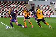 Tranmere Rover's Kieron Morris (7) under pressure from Newport County's Captain Joss Labadie (4) during the EFL Sky Bet League 2 match between Newport County and Tranmere Rovers at Rodney Parade, Newport, Wales on 17 October 2020.