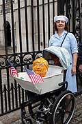 A female NHS nurse with a mock pram and fake Donald Trump head during a demonstration against U.S. President Donald Trumps state visit to the U.K on the 4th June 2019 in London in the United Kingdom. Day two of President Trumps three-day state visit, which includes lunch with the Queen, a State Banquet at Buckingham Palace as well as business meetings with the Prime Minister and the Duke of York, before travelling to Portsmouth to mark the 75th anniversary of the D-Day landings.