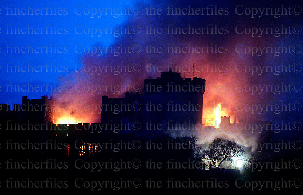 Windsor Castle blazing away in November 1992. The castle was partly destroyed by an electrical fire. Photographed by Jayne Fincher