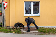 """A policeman looking with his dog for explosives during the preparations for Czech president Milos Zeman's """"meetings with citizens"""" at the village of Brasy located in the Pilsen Region.  Miloš Zeman (born 28 September 1944) is the third and current President of the Czech Republic, in office since 8 March 2013.  He announced his candidacy for the 2018 presidential elections which will be held in the Czech Republic on 12–13 January."""