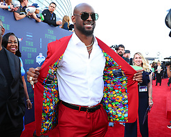 April 26, 2018 - Arlington, TX, U.S. - ARLINGTON, TX - APRIL 26:  Rashaan Evans shows the inside of his jacket on the Red Carpet prior to the 2018 NFL Draft at AT&T Statium on April 26, 2018 at AT&T Stadium in Arlington Texas.  (Photo by Rich Graessle/Icon Sportswire) (Credit Image: © Rich Graessle/Icon SMI via ZUMA Press)