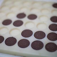 Pure tablets of 100% cocoa at the cocoa testing lab at NORANDINO de Café, Piura, Peru.