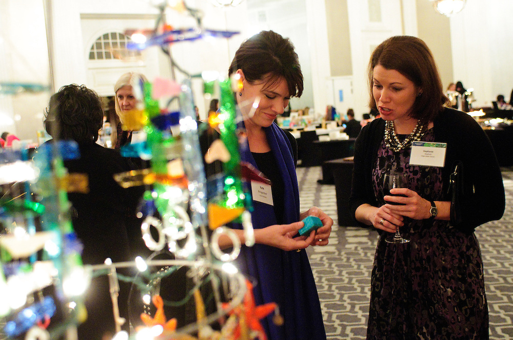 Faegre Baker Daniels LLP Partner Stephanie A. Gumm (R) reviews a holiday bazaar selection with Vocal Dynamics Owner S. Kate Bringardner during an event hosted by the women of Gumm's law firm at the W Chicago City Center Hotel on Thursday, November 29th. The second annual event features 25 booths featuring female entrepreneurs, artisans and artists. © 2012 Brian J. Morowczynski ViaPhotos