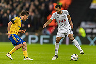 Tottenham Hotspur midfielder Mousa Dembele tries to evade Juventus forward Paulo Dybala during the Champions League match between Tottenham Hotspur and Juventus FC at Wembley Stadium, London, England on 7 March 2018. Picture by Toyin Oshodi.