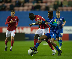 Famara Diedhiou of Bristol City (L) and Jamal Lowe of Wigan Athletic in action - Mandatory by-line: Jack Phillips/JMP - 11/01/2020 - FOOTBALL - DW Stadium - Wigan, England - Wigan Athletic v Bristol City - English Football League Championship