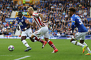 Marko Arnautovic of Stoke City (c) runs between Yannick Bolasie and Mason Holgate of Everton. Premier league match, Everton v Stoke city at Goodison Park in Liverpool, Merseyside on Saturday 27th August 2016.<br /> pic by Chris Stading, Andrew Orchard sports photography.