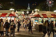 Shoppers throng the Union Square Holiday Market in New York City on its opening day in 2014.