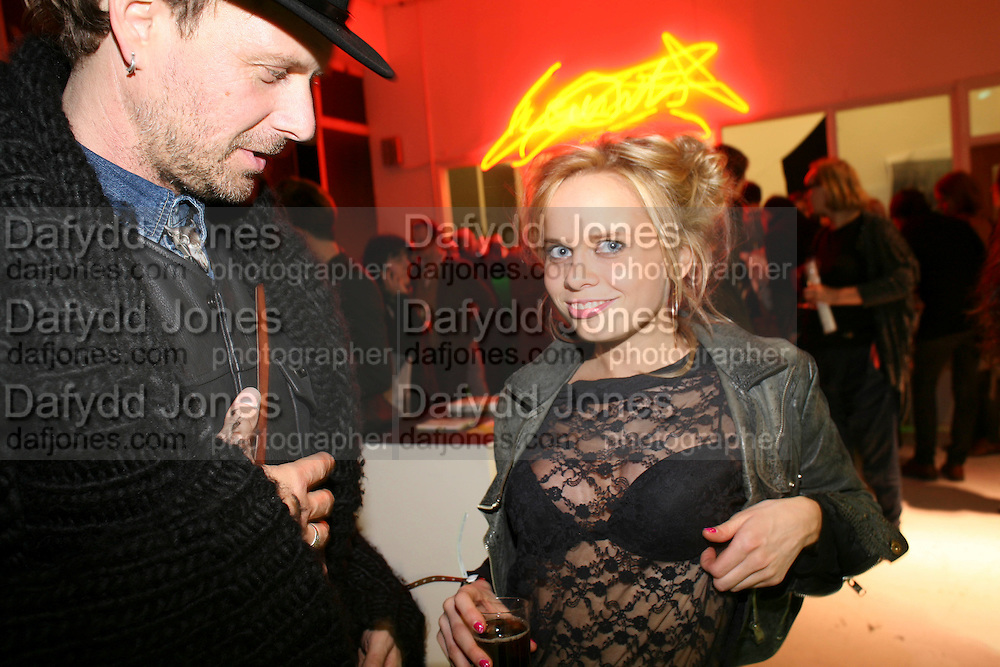 GREG RUMPLE STILTSKIN;  SCARLETT CARLOS CLARKE, Opening of Plus Art, a group exhibition produced by  Kerry Ryan and artist Declan McMullan. Britannia House,  Hanbury Street, off Brick Lane. E1 5JL. was open for 24 hours a day during the  Frieze Art Fair period..- 15 October 2010. <br />