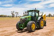 John Deere 7280R tractor with Krone hay baler in a field near Nurrabiel, Victoria, Australia. <br /> <br /> Editions:- Open Edition Print / Stock Image