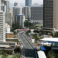 20-22 October, 2006, Surfers Paradise, Queensland, Australia.<br /> The field heads past the second chicane toward the Q1 tower at the start.<br /> © 2006 Phillip Abbott/USA<br /> LAT Photographic