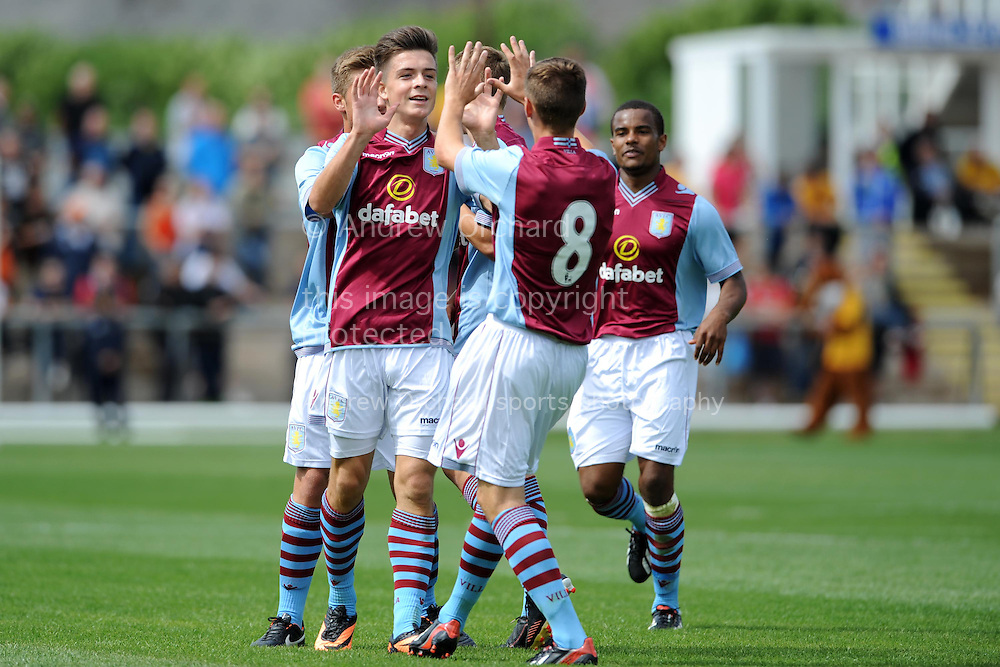 Aston Villa's Jack Grealish celebrates after he scores his sides 1st goal. Pre-season friendly football match, Newport county  v Aston Villa at Rodney Parade in Newport, South Wales on Sunday 28th July 2013. pic by Jeff Thomas,  Andrew Orchard sports photography,