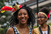 Dancers as part of the opening ceremony - The Sunday of the Notting Hill Carnival. The annual event on the streets of the Royal Borough of Kensington and Chelsea, over the August bank holiday weekend. It is led by members of the British West Indian community, and attracts around one million people annually, making it one of the world's largest street festivals.