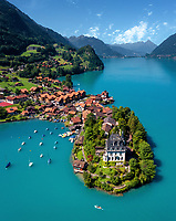 Aerial view of Iseltwald with is Castle Seeburg, boats, houses and lake in Canton of Bern, Switzerland