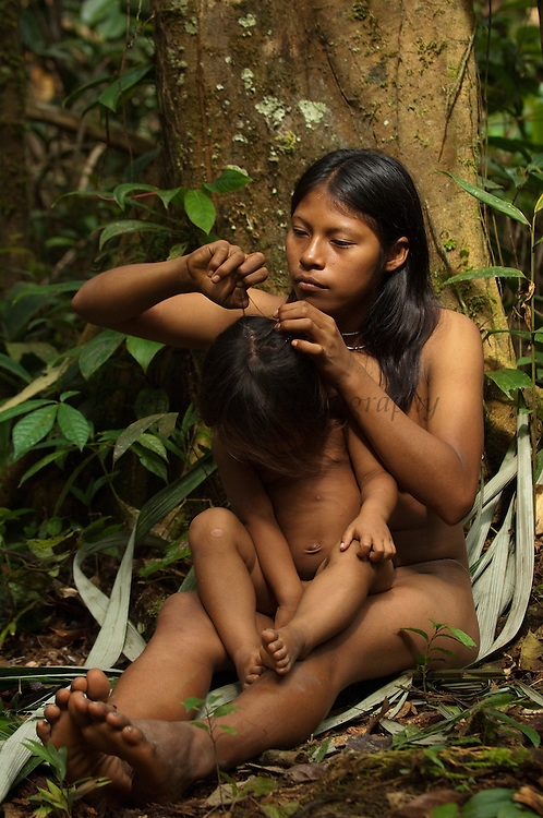 Huaorani Indian girls - Carmen Kaiga & Romelia Andy. Gabaro Community. Yasuni National Park.<br /> Amazon rainforest, ECUADOR.  South America<br /> This Indian tribe were basically uncontacted until 1956 when missionaries from the Summer Institute of Linguistics made contact with them. However there are still some groups from the tribe that remain uncontacted.  They are known as the Tagaeri. Traditionally these Indians were very hostile and killed many people who tried to enter into their territory. Their territory is in the Yasuni National Park which is now also being exploited for oil.