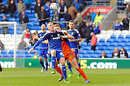 Cardiff City's Lex Immers (c) is challenged by Ipswich's Luke Hyam (19). Skybet football league championship match, Cardiff city v Ipswich Town at the Cardiff city stadium in Cardiff, South Wales on Saturday 12th March 2016.<br /> pic by Carl Robertson, Andrew Orchard sports photography.