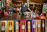 Eduardo Gigato prepares the inside of the shop at Little Havana Cigar Factory along Calle Ocho in Little Havana on  Tuesday, May 19, 2020 as many businesses and restaurants prepare for partial opening in the next several days.