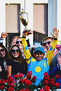 30174109A LOUISVILLE, KY. - MAY 2, 2015: Jockey Victor Espinoza holds up his trophy after winning the 141st running of the Kentucky Derby at Churchill Downs.<br /> <br /> William DeShazer for The New York Times Processed with VSCO with 4 preset