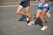 legs of two runners at the New York marathon