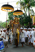 Barong Landung, magically protective effigies common in many villages in Bali, in procession to village temple as part of the celebration of Galungan. Galungan celebrates the victory of virtue (Dharma) over evil (Adharma) and is perhaps the most important religious holiday for Balinese Hindus. Sanur, Bali, Indonesia