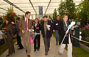 Mr. and Mrs. Richard E. Grant, Jools Holland and Cristabel Durham/Holland? Chelsea Flower Show. 19 May 2003. © Copyright Photograph by Dafydd Jones 66 Stockwell Park Rd. London SW9 0DA Tel 020 7733 0108 www.dafjones.com